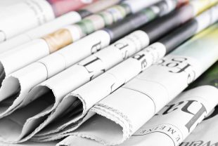A stock image of newspapers representing what has been in the news today