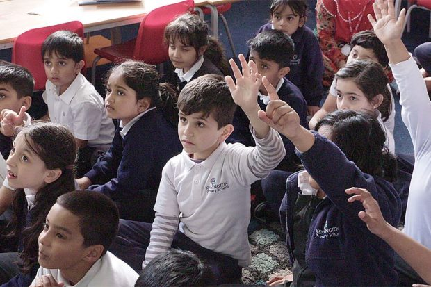 a classroom of children engaging in a lesson